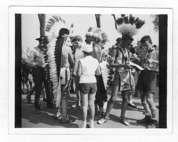 Scouts wearing Indian head dresses