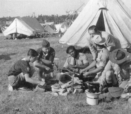 Scouts cooking in camp