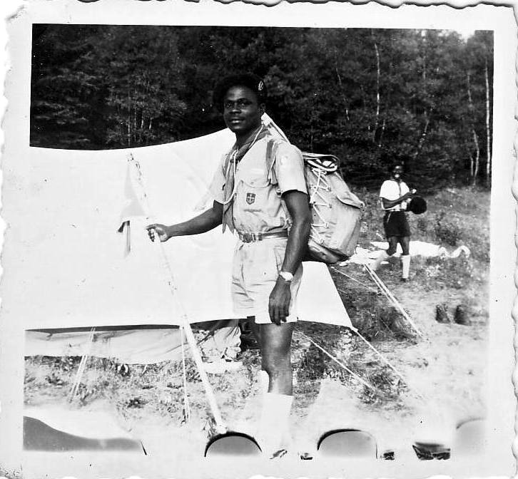 Kouassi by his tent at WJ'55